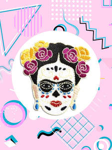 iron on patch shaped like Frida Kahlo wearing day of the dead makeup