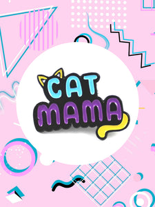Blue and purple enamel pin that has cat ears and a tail that says, cat mama.
