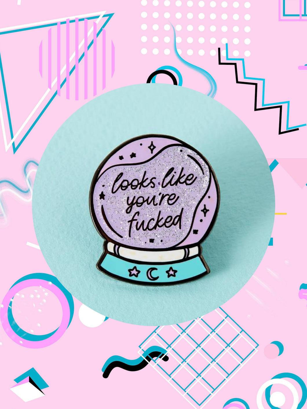 enamel pin shaped like a crystal ball that says, Looks Like You're Fucked