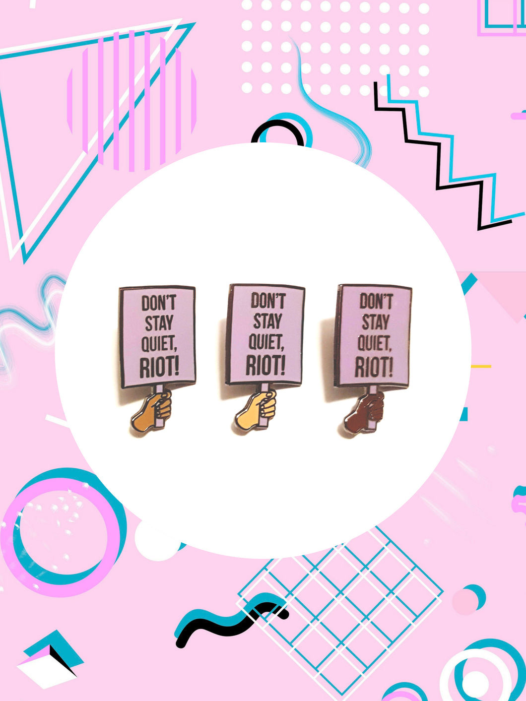 Enamel pin of a hand holding a protest sign that says, don't stay quiet, riot. Don't Stay Quiet Riot Enamel Pins
