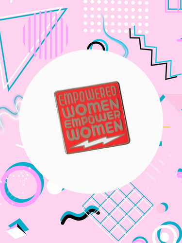 enamel pin that says, empowered women empower women