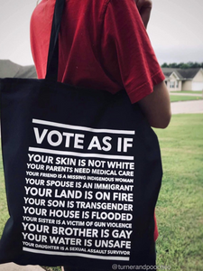 black canvas tote that says, vote as if your skin is not white, your parents need medical care, your friend is a missing indigenous woman, your spouse is an immigrant, your son is transgender, and your daughter is a sexual assault survivor