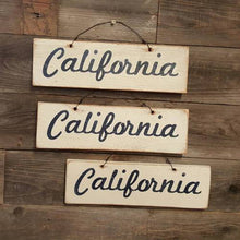 Weathered Souvenir Signs - visitors