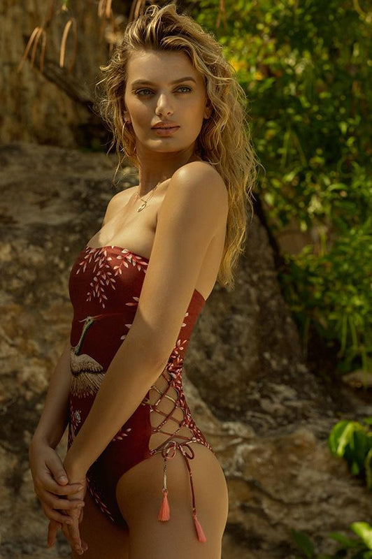 agua bendita strapless one piece with caged details at sides and provides moderate coverage at rear