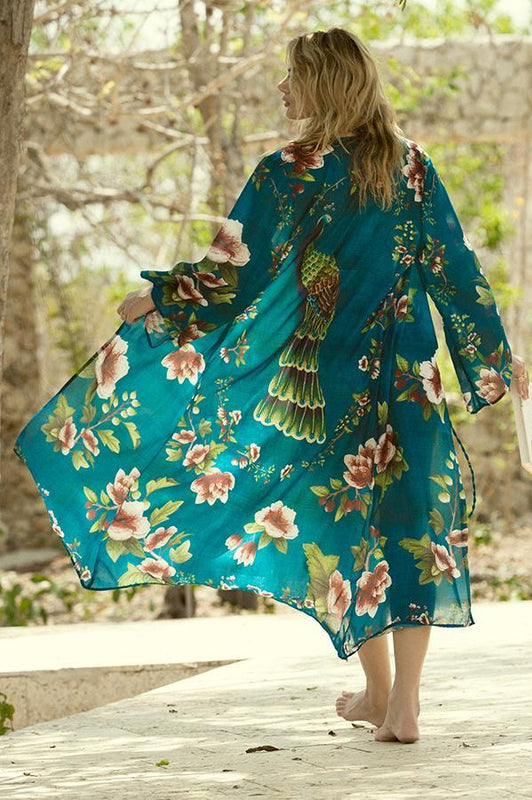 agua bendita maxi tunic features an open front and a long sleeved design with a floral print
