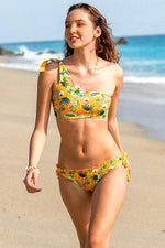 MAYLANA SWIMWEAR TROPICAL ONE SHOULDER CROP TOP SWIMSUIT WITH TROPICAL PRINT REVERSIBLE TO MUSTARD