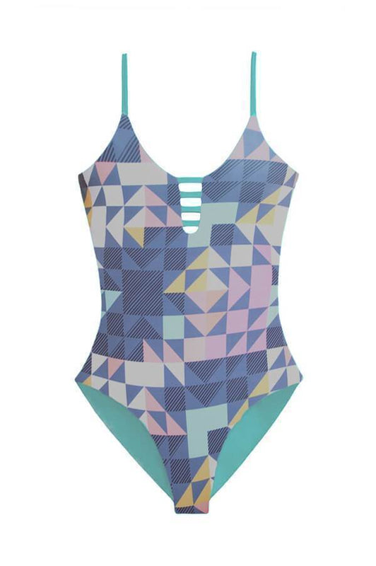 Maylana caged one piece provides moderate coverage at rear and reverses to aqua
