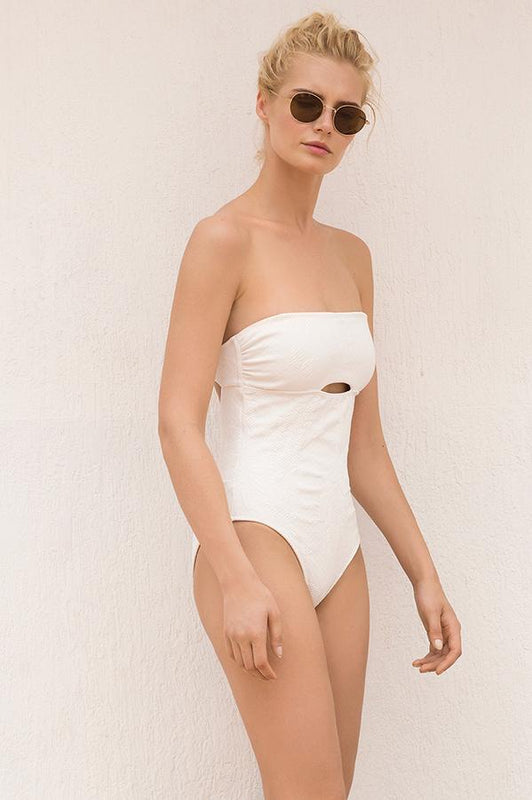 Touche one piece features solid textured fabric with open design at front and back