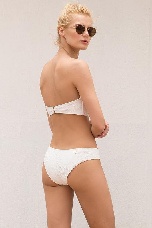 Touche women white bottom features solid textured fabric with moderate coverage at rear