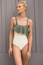 One piece swimsuit by Touche with ruffles and cut out details