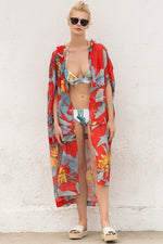 Hooded beach tunic with tropical print by Touche Swimwear