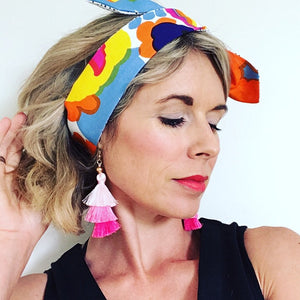 KarlaCola Floral Headband Made with Marimekko Fabric worn with earring from Sassi the Collection.
