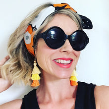 KarlaCola Orange Floral Headband Made with Marimekko Fabric worn with earrings by Sassi the Collection.