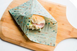 reusable beeswax wrap medium size used to wrap bread roll for lunch