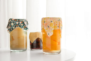 reusable beeswax wraps covering preserves in jars