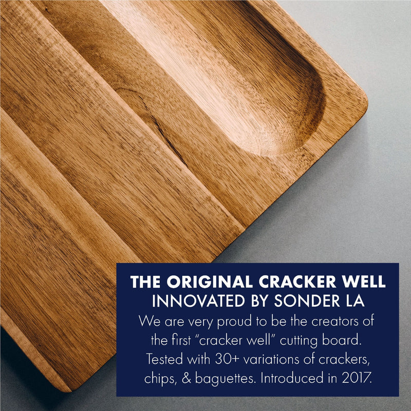Winsome Acacia Wood Cutting Board by Sonder Los Angeles, features signature built-in cracker well, reversible, multipurpose, multifunctional, with deep juice grooves, and interior handles for easily lifting