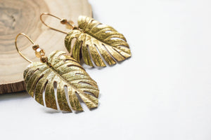 Monstera leaf earrings in gold leather