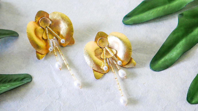Orchid earrings in gold colour statement leather earrings