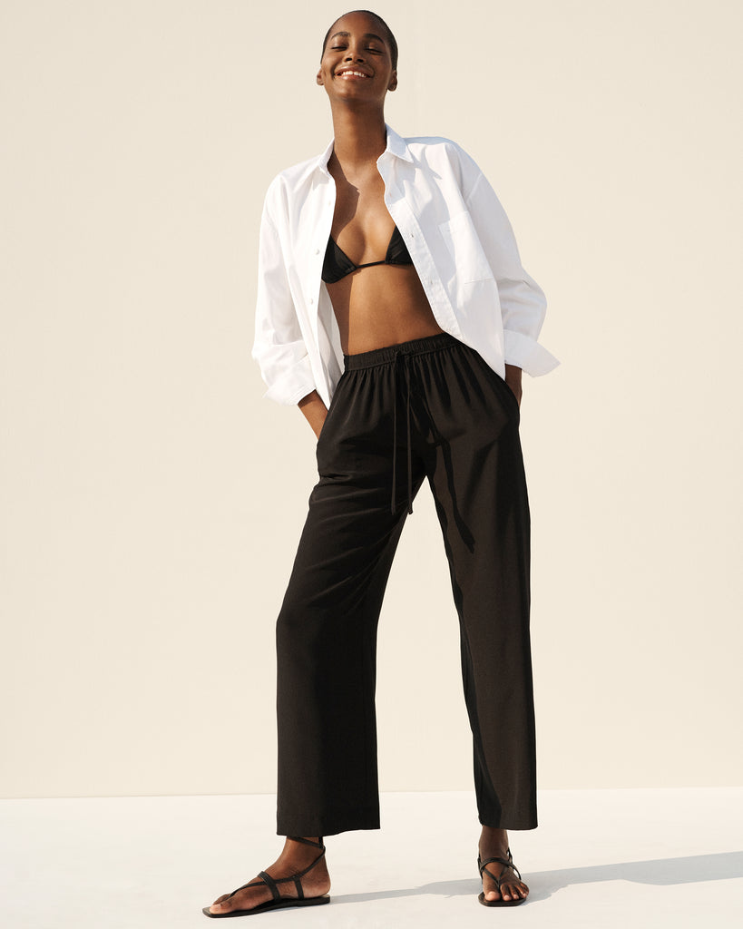 Tami Williams wears our String Triangle Top, Classic Pocket Shirt and Drawstring Trouser
