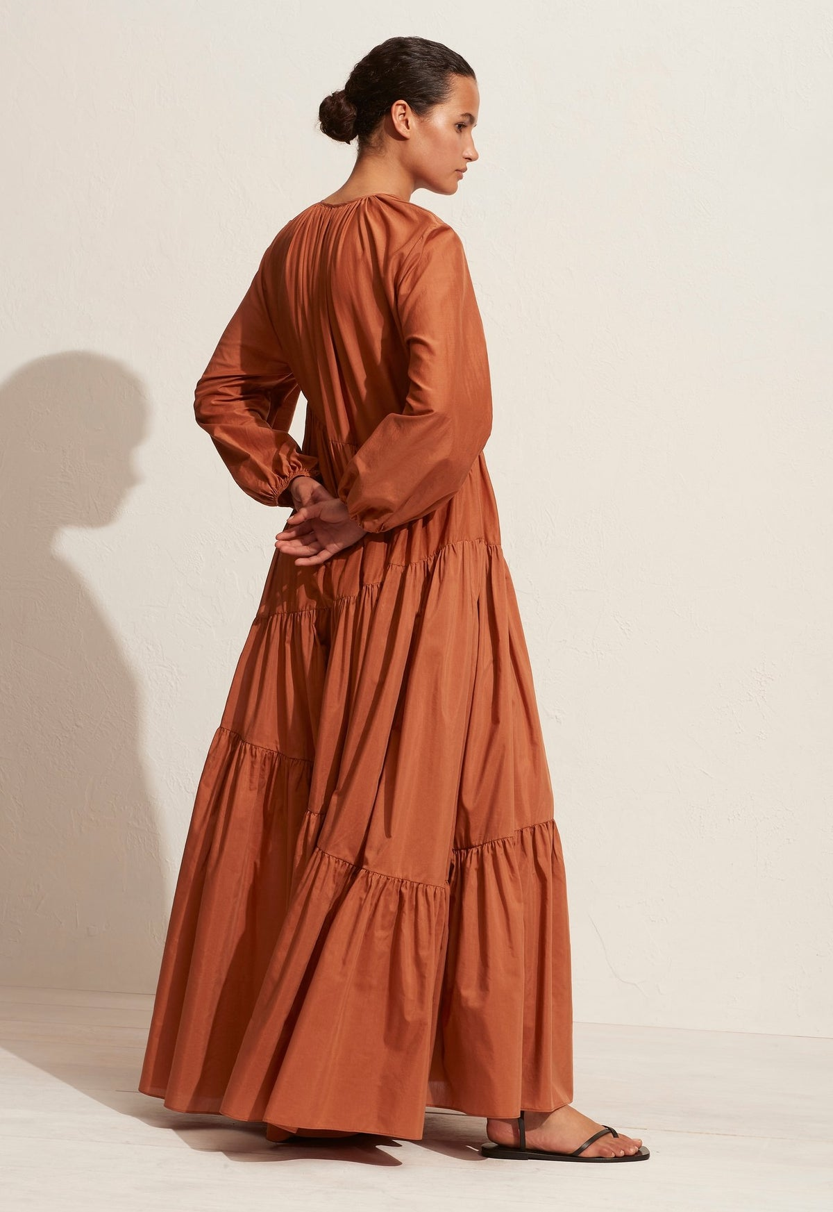The Asymmetric Tiered Long Sleeve Dress