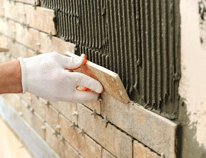 Reclaimed Brick Slips being fixed, image