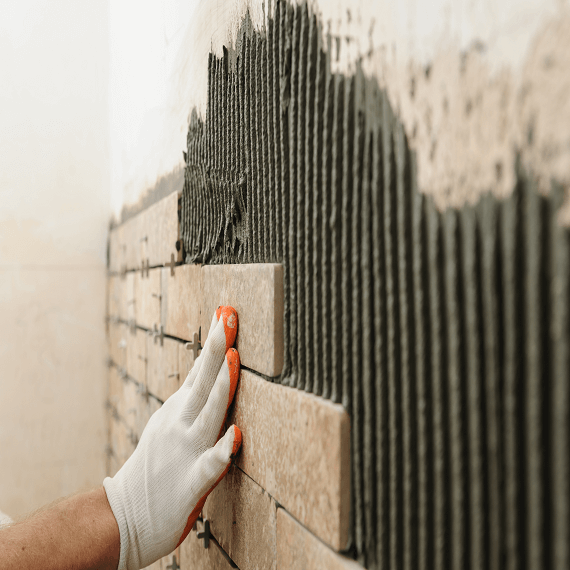 brickslips being applied with adhesive