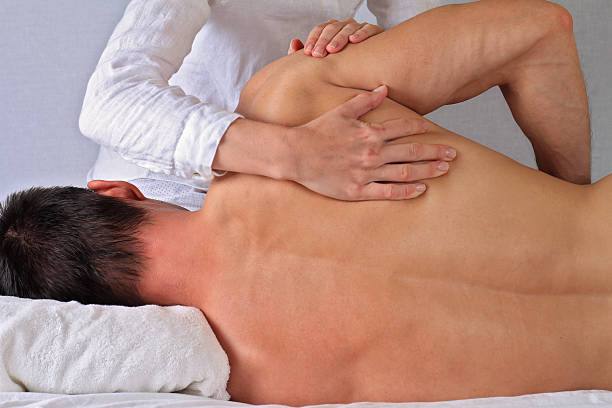 Sports massage for a male patient
