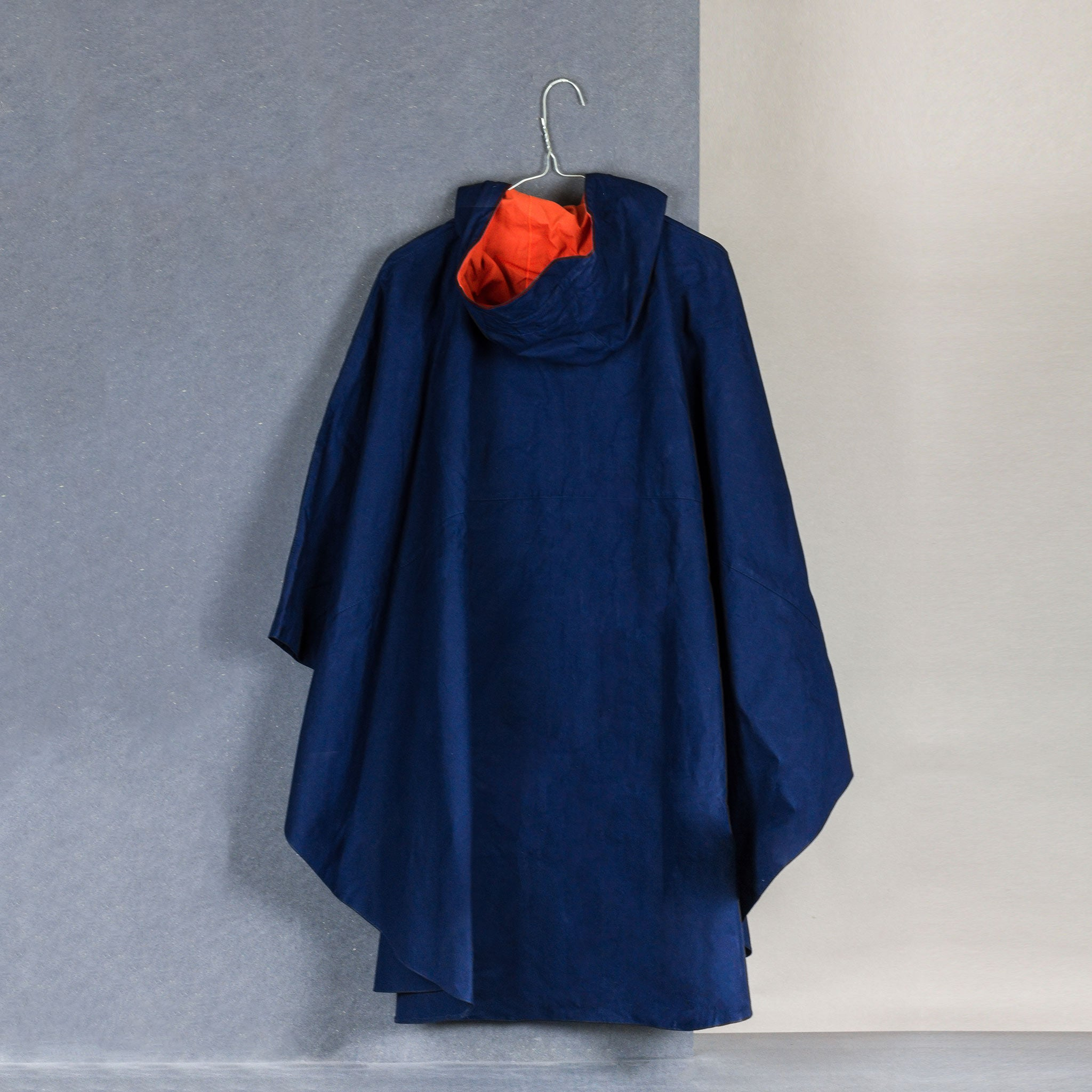 Calton Hill Edinburgh Scotland Collective Matter x Panel Rain Poncho Unisex Katie Schwab with Halley Stevensons and Greenhills Clothing Mary Quant Dark Navy Orange Waxed Cotton