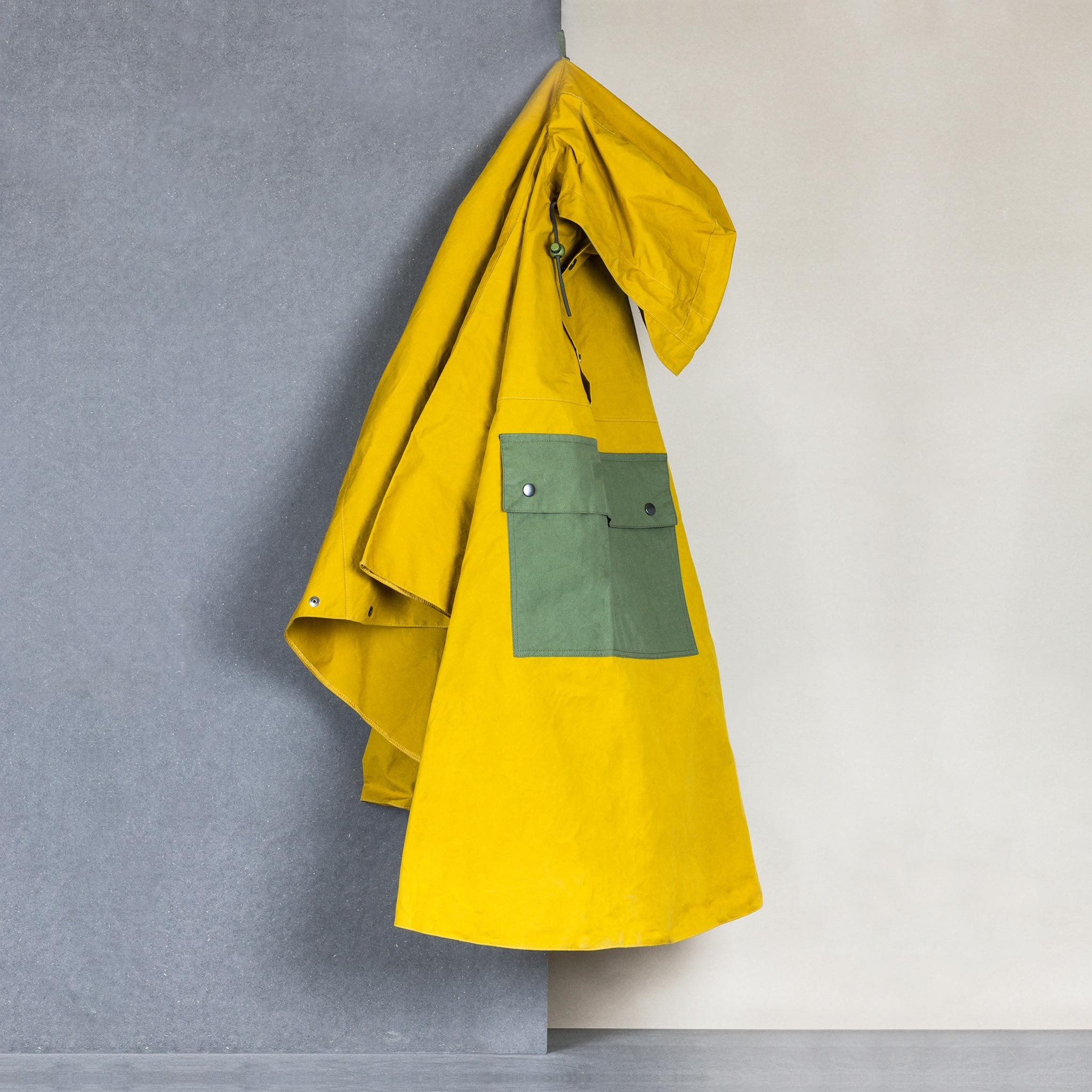 Calton Hill Edinburgh Scotland Collective Matter x Panel Rain Poncho Unisex Katie Schwab with Halley Stevensons and Greenhills Clothing Mary Quant Cumin Racing Green Waxed Cotton
