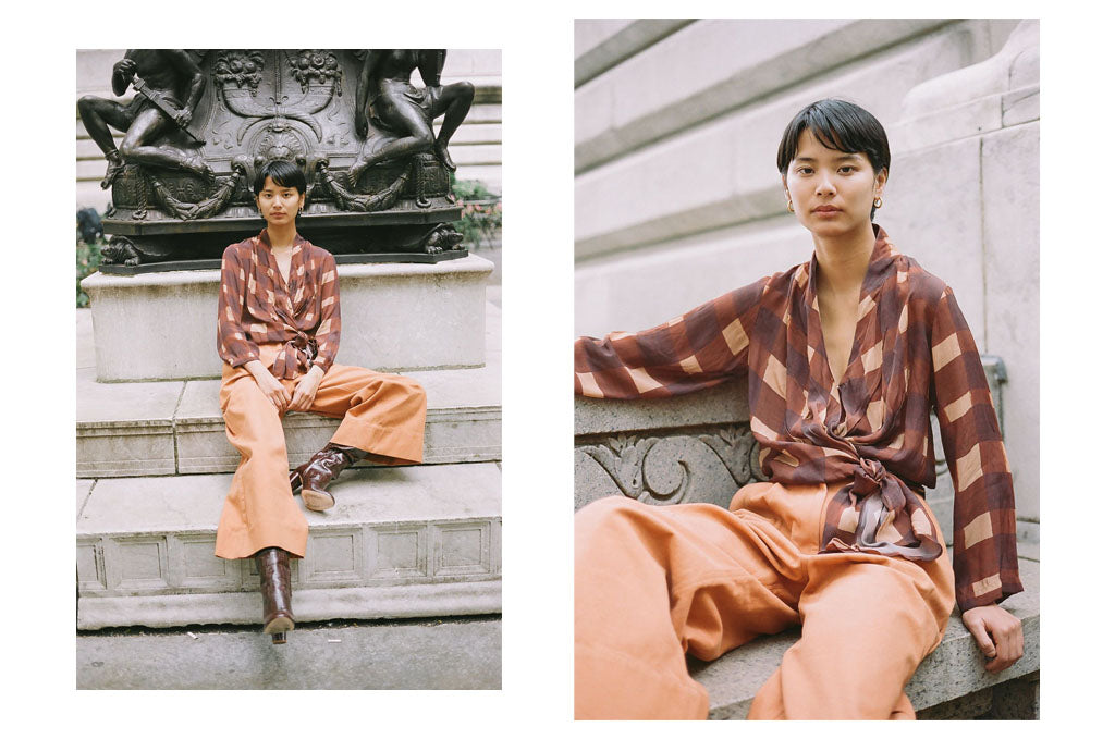 A hand painted print wrap top and wide leg rust cotton trousers.