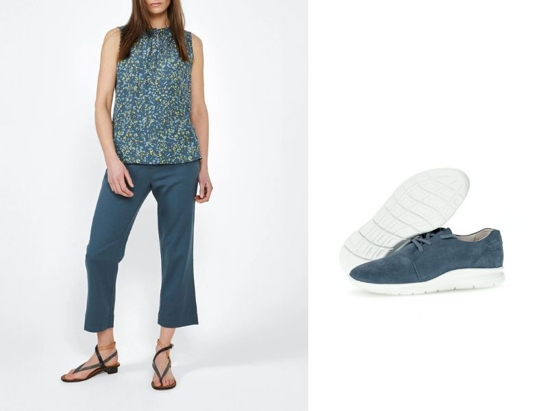 Sandwich Belted Ankle Pant in dusty blue has a fabric belt and comes above the ankle. It is shown with Gabor Nubuck Sneaker in dusty blue. The sneaker has dusty blue laces and has a white rubber sole.