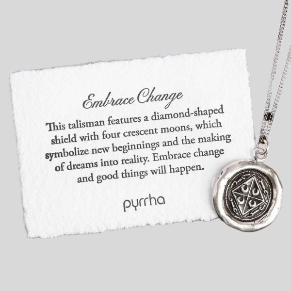 """A pendant is shown, with a card that reads Embrace Change. This talisman features a diamond-shaped shield with four crescent moons, which symbolize new beginnings and the making of dreams into reality. Embrace change and good things will happen."""""""