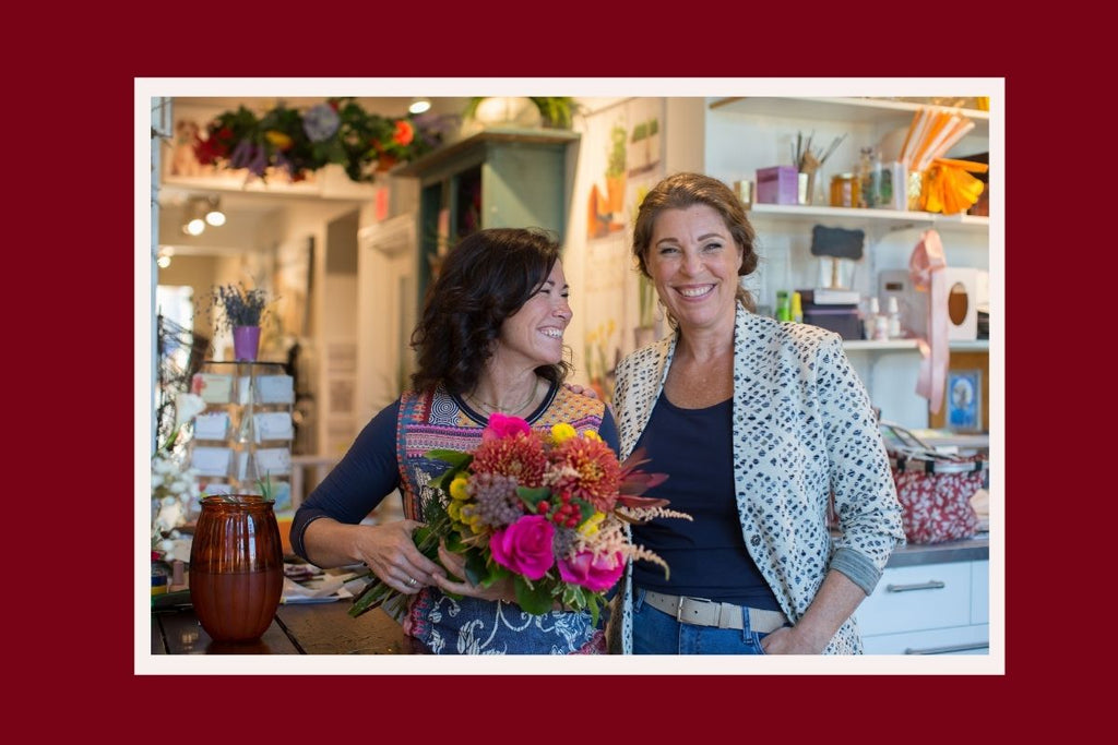 Cate Hishon and Resonance founder Jo Gordon smile together in Cate's Stratford floral shop, Designs By Cate.