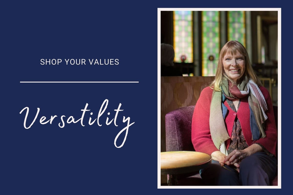 On the left, a headline reads: Shop Your Values - Versatility. In the photograph, Judy MAtheson sits in a chair with a large stained glass window behind her. She smiles at the camera and is dressed in a red cardigan, a multicoloured scarf.