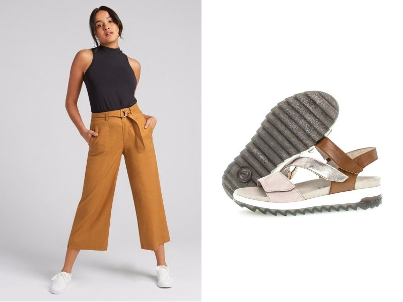 FIG Karjini pant is shown in a tan colour. It has a fabric belt and a wide, loose leg. It is shown with a Gabor Gabor Multicolour 3 Strap Sandal. It has a sporty look with a thick sole. Leather straps are tan, metallic gold and light beige.