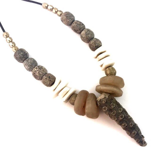 Driftwood short necklace + stegodon fossil + naga shells + African trade beads