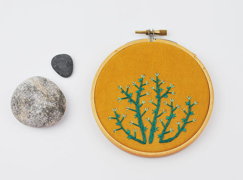 Teal Plant Embroidery on Hand Dyed Mustard Colored Linen/Cotton Blend finished piece