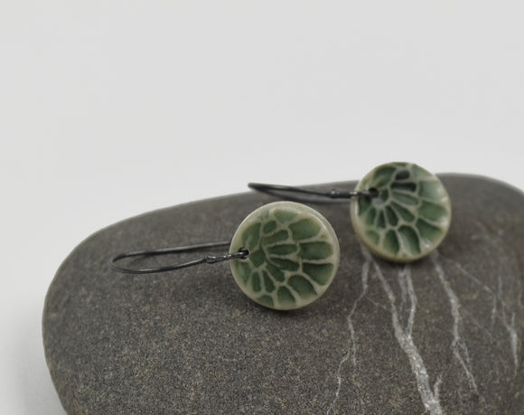Small Celadon Flower Disk-- Porcelain on oxidized silver kidney hooks