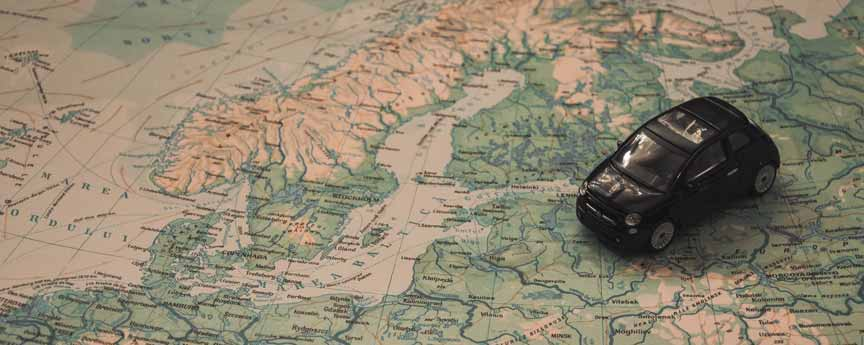 A black toy car on a map