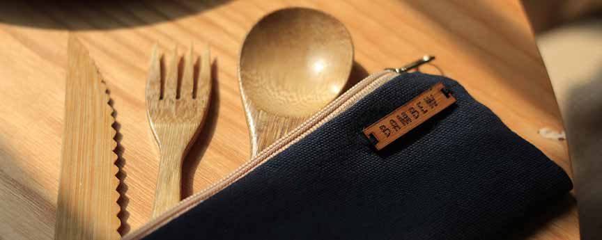 A set of bamboo cutlery in wool pouch