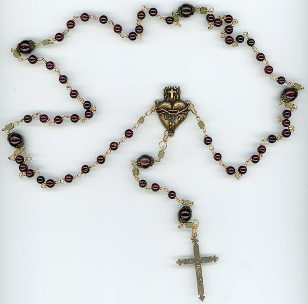 I love this rosary!  Garnets and Bronze!