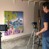 Johnny Botts photographing Fitz Roy painting