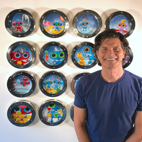 Johnny Botts with his art for foursquared show at Arc Gallery
