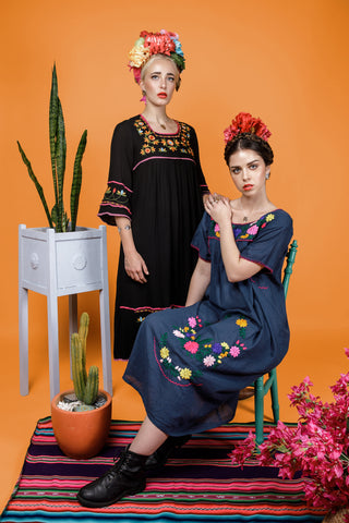 Models wear the monstera necklace, drop earrings, bracelets and rings for the Frida Kahlo Collection lookbook