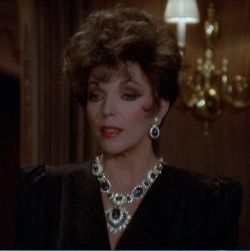Joan Collins in Ruby, Emerald, And Sapphire Necklace