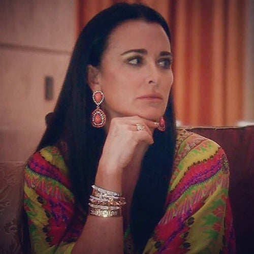 Kyle Richards in the Coral Teardrop Clip Earrings