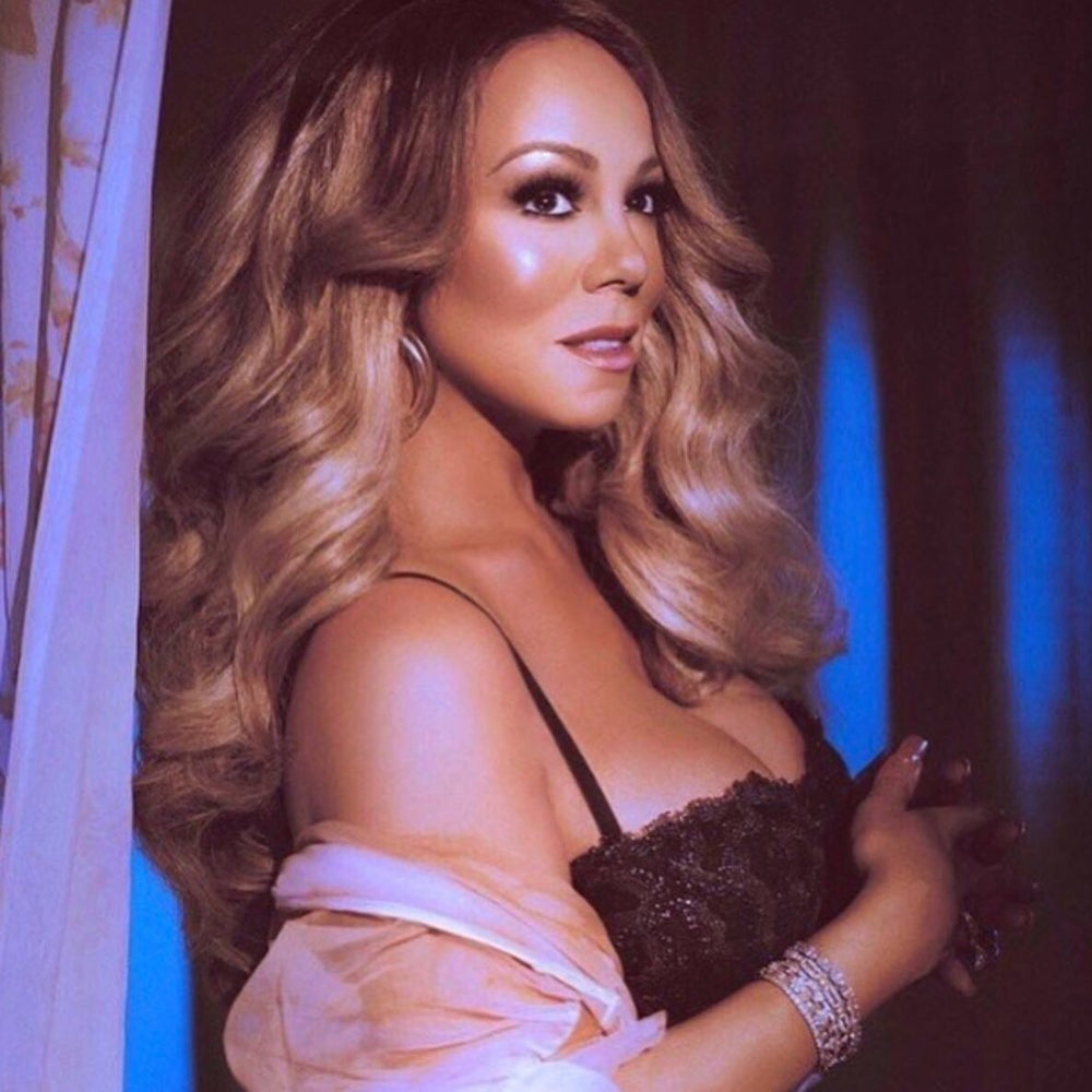 Mariah Carey in the Clear Doorknocker Clip Earrings