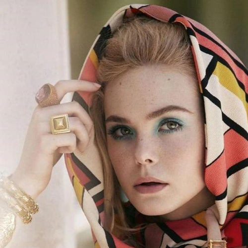 Elle Fanning in Antique Gold and Coral with Amethyst Center Ring