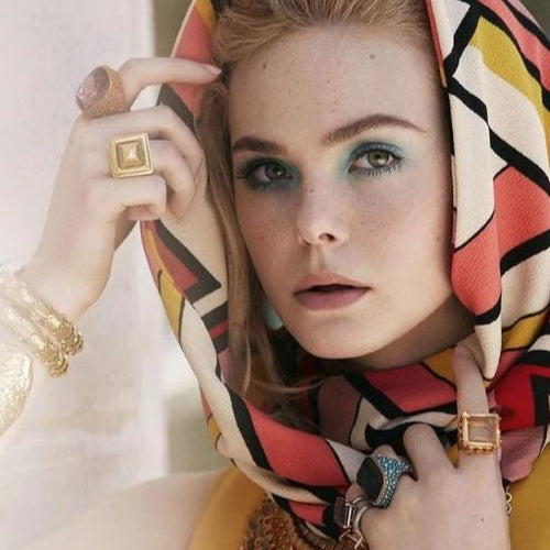 Elle Fanning in Antique Gold and Turquoise with Sapphire Center Ring