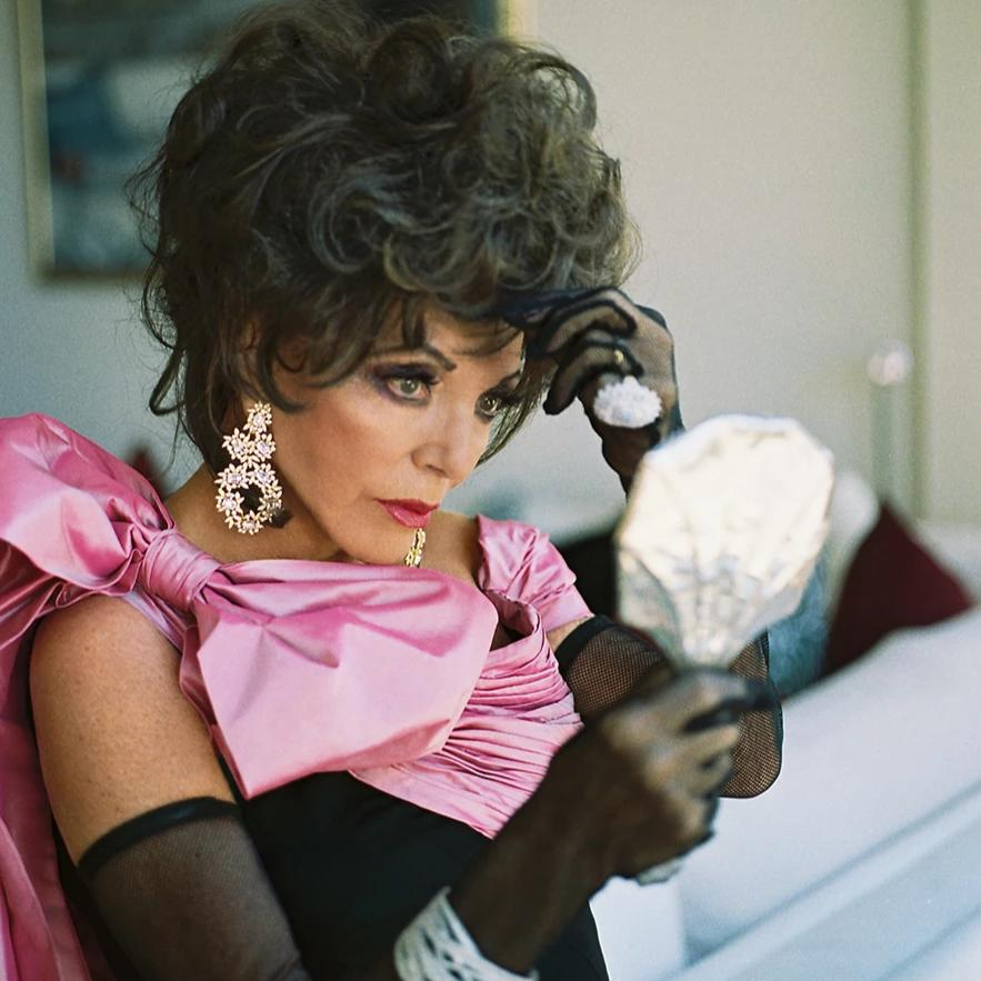 Joan Collins in Silver & Crystal Flower Clip Earrings